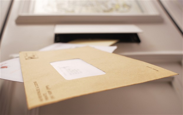 Photo of a letter arriving in the post