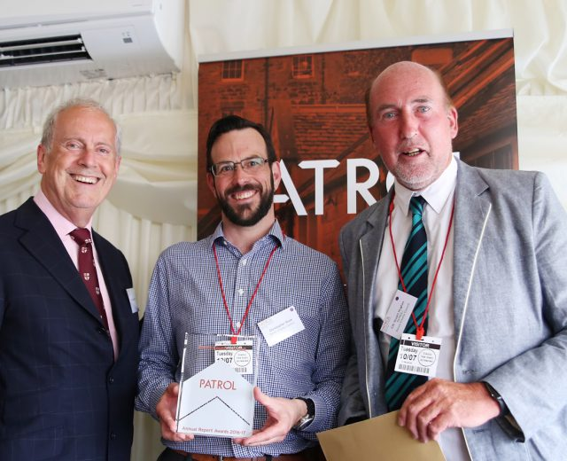 Photo of Councillor Stuart Hughes, Devon County Council; a representative from Brighton & Hove City Council and Gyles Brandreth at the Parking Annual Reports by Councils (PARC) Awards 2018