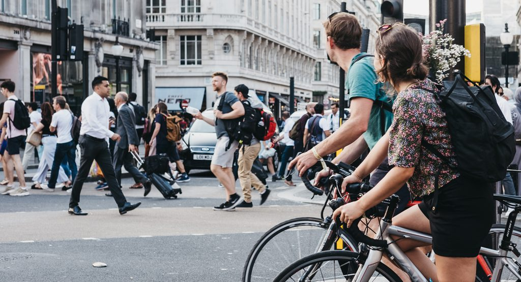Cyclists and pedestrians on a busy city street